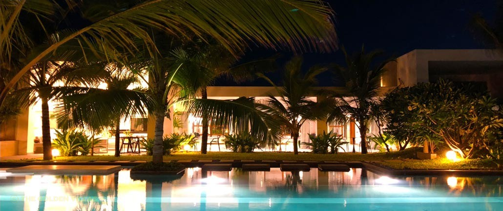 The long poolside at night