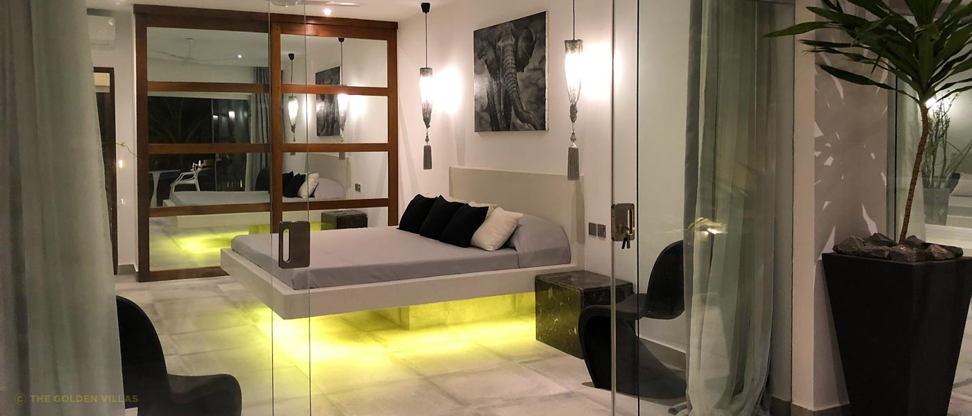 Bedroom with under bed illumination and sliding doors